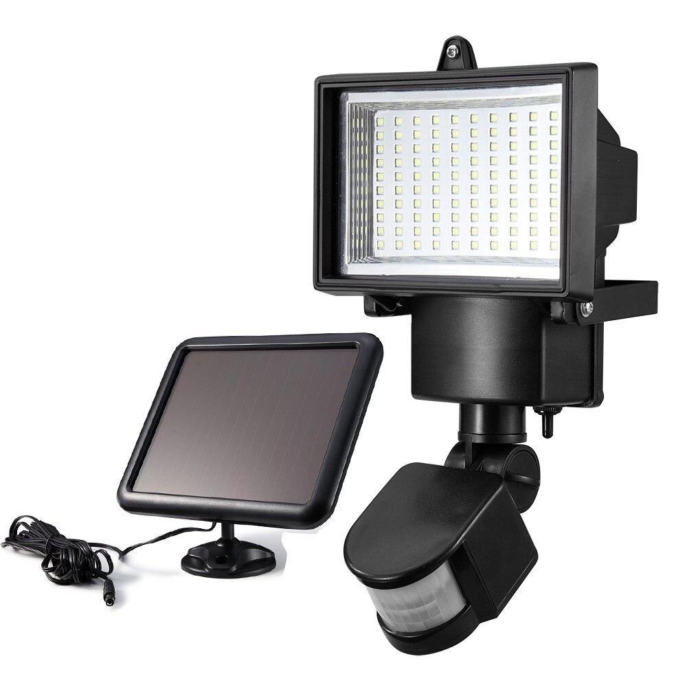 Купить на aliexpress Светодио дный 100 светодиодный солнечный свет с светодио дный датчиком движения и солнечной панелью открытый светодиодный прожектор лампа б...