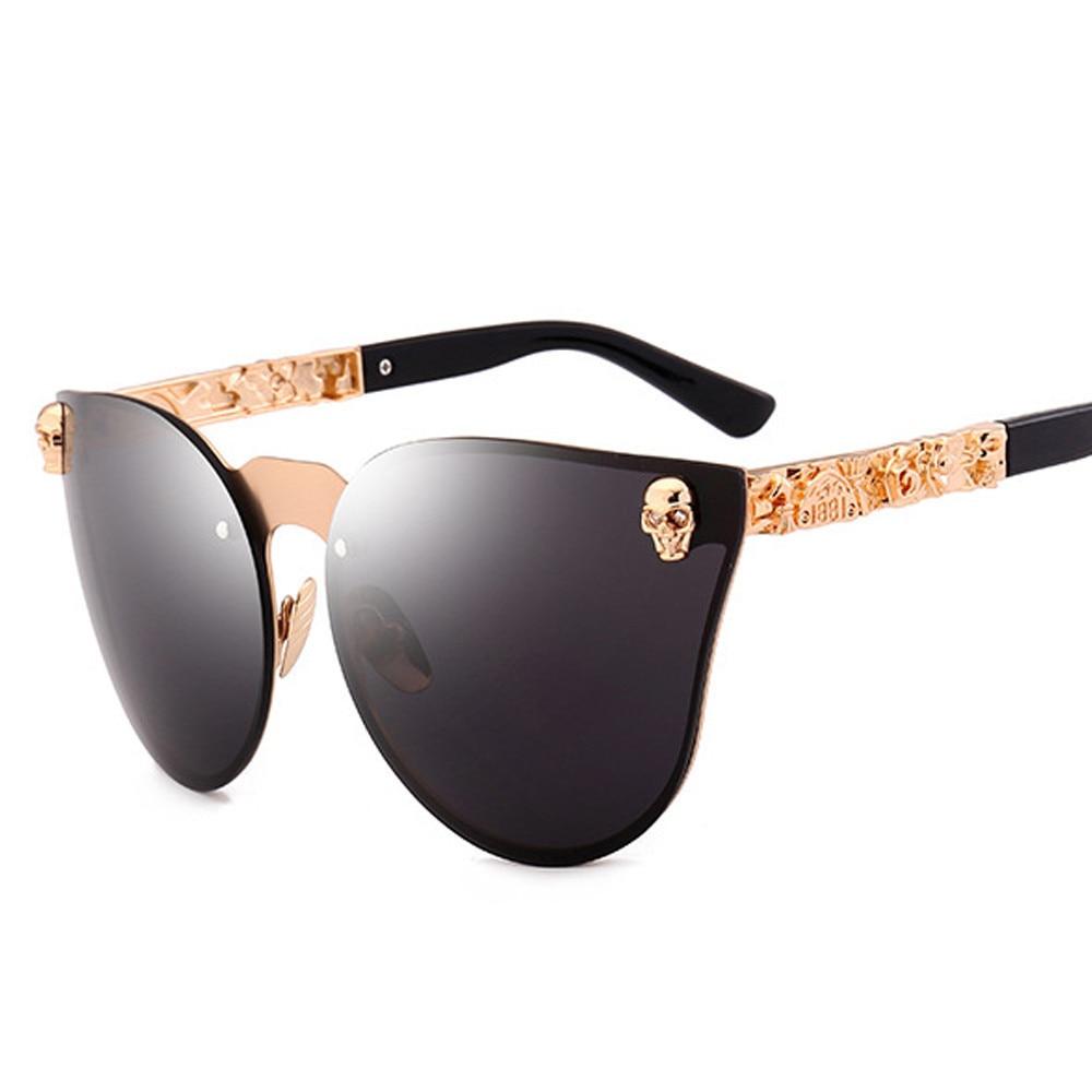 Vintage gafas de sol de las mujeres hombres gótico gafas cráneo Metal templo femenino gafas de sol de UV400