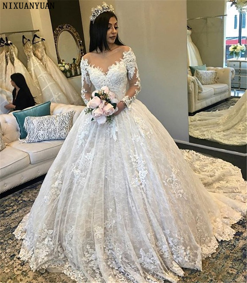 Amazing New Puffy Wedding Dresses 2019 Sheer Neck Long Sleeves Ball Gown Chapel Train Beaded Lace Bride Dress Mariage