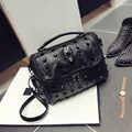 Sheepskin patchwork 2017 women's rivet handbag skull portable small square package casual single shoulder cross-body bag