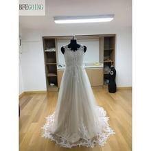 Платье без рукавов из тюля цвета слоновой кости с треугольным вырезом, длина до пола
