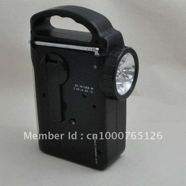 Multi-function solar LED hand crank dynamo flashlight with radio
