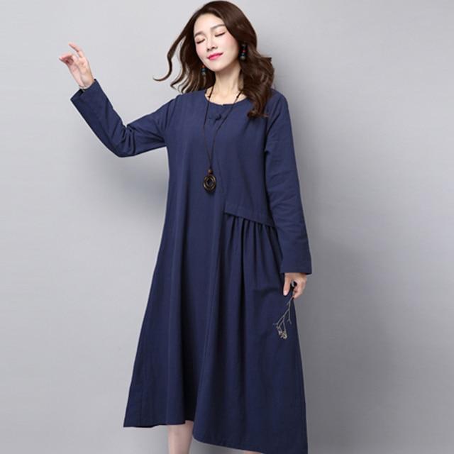 Blauw jurkje met lange mouwen