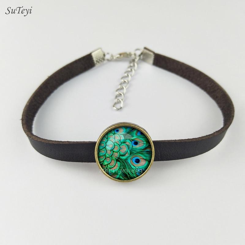 SUTEYI 2017 Nouveau paon plume Bracelet abstrait plumes bijoux Art Nouveau verre paon Photo cuir bracelets pour femme