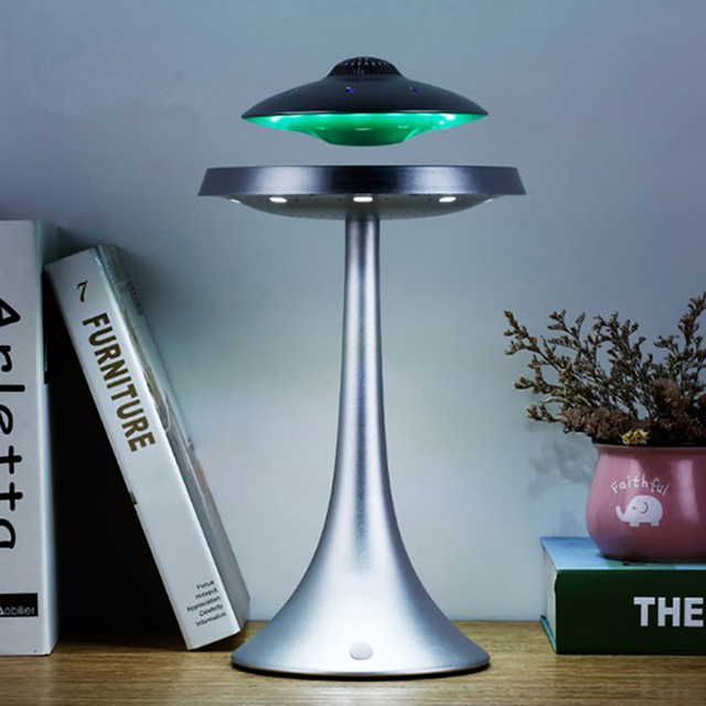Smart Bluetooth speakers bass stereo Magnetic suspension UFO style design seven color LED lights waterproof wireless charging