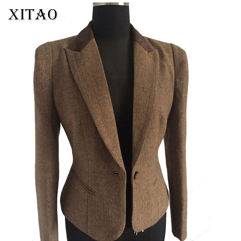 Black Chanel wool tweed blazer featuring notched lapels, three-quarter sleeves, interlocking CC button accents at sides, gold-tone chain-link accent at interior hem and interlocking CC button closures at front.