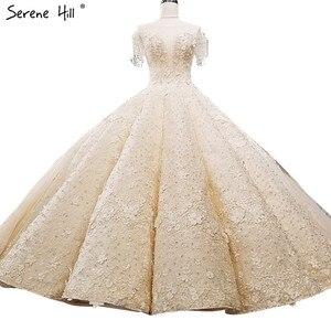 Image 1 - קיצוני יוקרה ללא שרוולים סקסי בציר חתונה שמלות 2020 קריסטל פרחי מותאם אישית high end טול הכלה שמלה