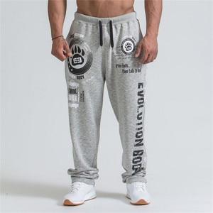 Image 1 - 2019 novos homens joggers cor sólida calças esportivas calças de ginásio de algodão elástico calças compridas homens rendas calças esportivas masculinas leggings