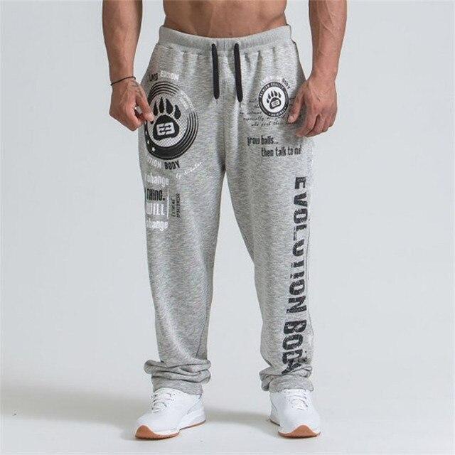 2019 חדש גברים רצים מוצק צבע ספורט מכנסיים גברים כושר מכנסיים כותנה אלסטי ארוך מכנסיים גברים שרוכים ספורט מכנסיים זכר חותלות