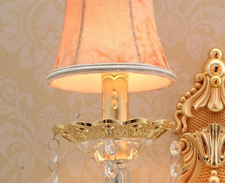 Oro riparo della parete con paralume moderno applique da parete