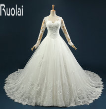 2016 New Arrival Real Sample Ball Gown Lace Applique Long Sleeves Beading Tulle Formal Church Wedding Dresses For Bridal