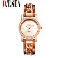 High Quality Fashion O T SEA Women Alloy Dial Quartz Analog Rhinestone Bracelet Wrist Watch 25809Luxury