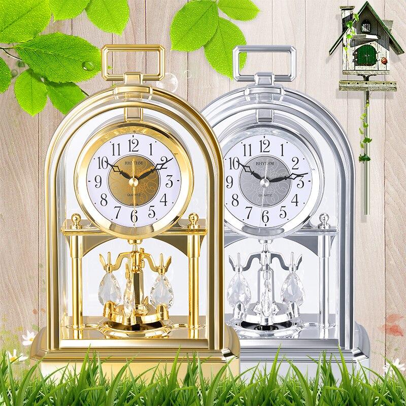 Marque silencieux mouvement sauteur horloge de Table cristal rotatif pendule horloge de bureau Masa Saati Saat or argent HD Anti-buée cloche visage