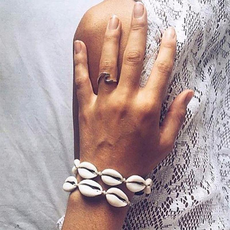Hot Sale Handmade Natural Seashell Hand Knit Bracelet Shells Bracelets Women Accessories Beaded Strand Bracelet SL 102 in Strand Bracelets from Jewelry Accessories