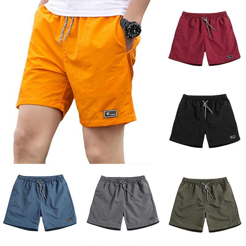 2019 New Modish Shorts Men Summer Plus Size 5XL Solid Thin Fast-drying Beach Trousers Casual Sports Short Pants Streetwear Homme
