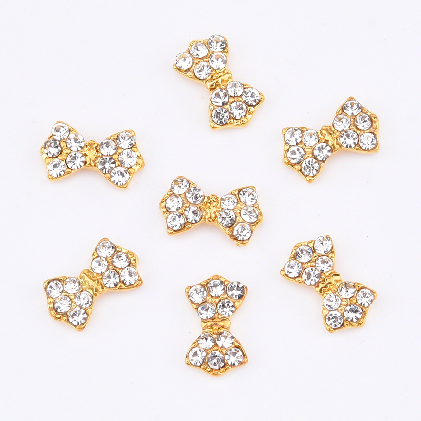 2077c94020 US $2.04 15% OFF|10pcs New design gold nail bows in crystal opal  rhinestones nail art decorations charms 2018 nails dekor supplies TCJ220-in  ...
