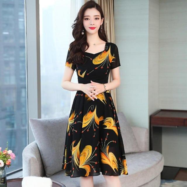 Vestido elegante con cuello redondo y manga corta para mujer