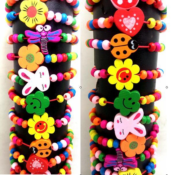 Prix pour 24 pcs Enfants Belle Bois Perles Bracelets Bracelets 12 conception de Mélange En Gros Enfants Fête D'anniversaire Faveur