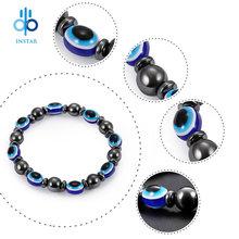 Модный мужской браслет из натурального камня с голубыми глазами