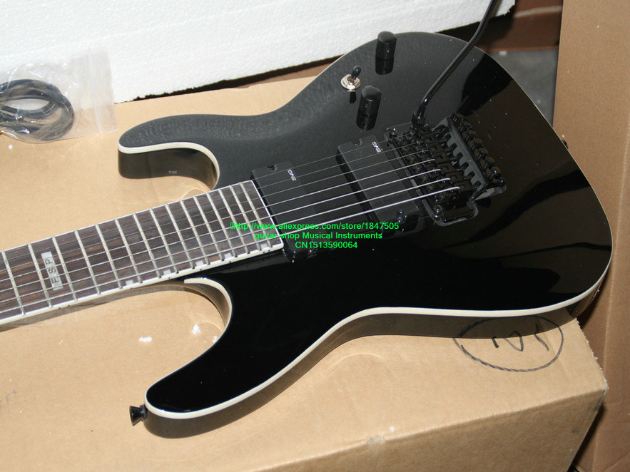 custom shop black 7 strings electric guitar one piece neck very tremolo device 7 string guitars. Black Bedroom Furniture Sets. Home Design Ideas