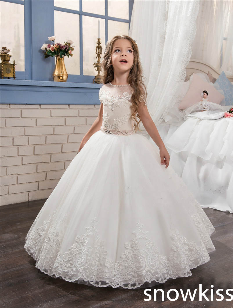 2018 white/ivory first communion dresses for little girl with lace appliques crystals tulle ball gown kids prom dress new hot pretty ivory or white appliques tulle beads sash flower girl dresses with train white girls first communion dresses