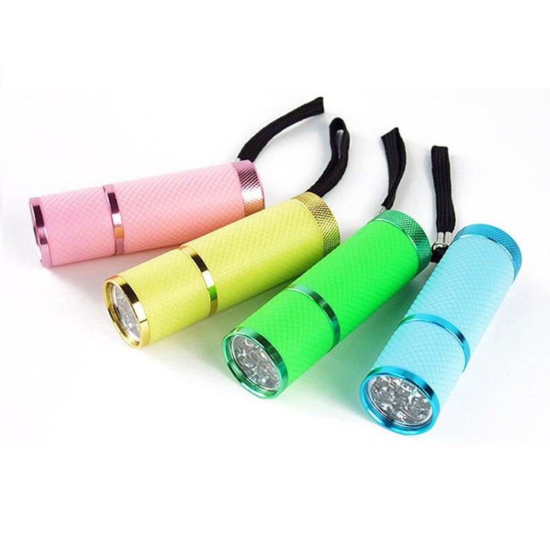Outils d'extérieur étanche Portable lumineux Mini 9 ampoule LED AAA piles poche lampe de poche en caoutchouc enduit corps torche en aluminium