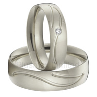 China Manufacturer arc shaped inside silver color CNC engrave pattern titanium steel wedding rings for men and women