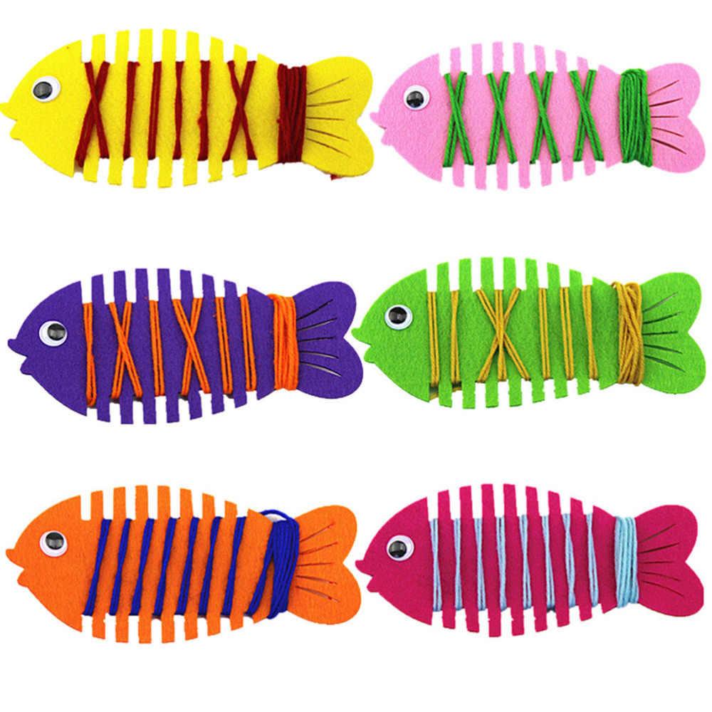 Juguetes de aprendizaje para bebés de colores al azar peces de dibujos animados Patience Thinking mano de coordinación entrenador línea de cuerda alrededor de peces