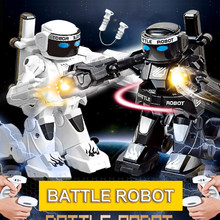 Battle RC Robot 2-CH 2.4G Body Feeling Remote Control Toy Robot With Boxing Sound And Indicative Light model Kids Gift(China)