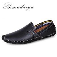 Precio Mocasines de cuero genuino BIMUDUIYU cómodos zapatos transpirables deslizantes en el barco mocasines de alta calidad para hombre zapatos planos transpirables Casuales