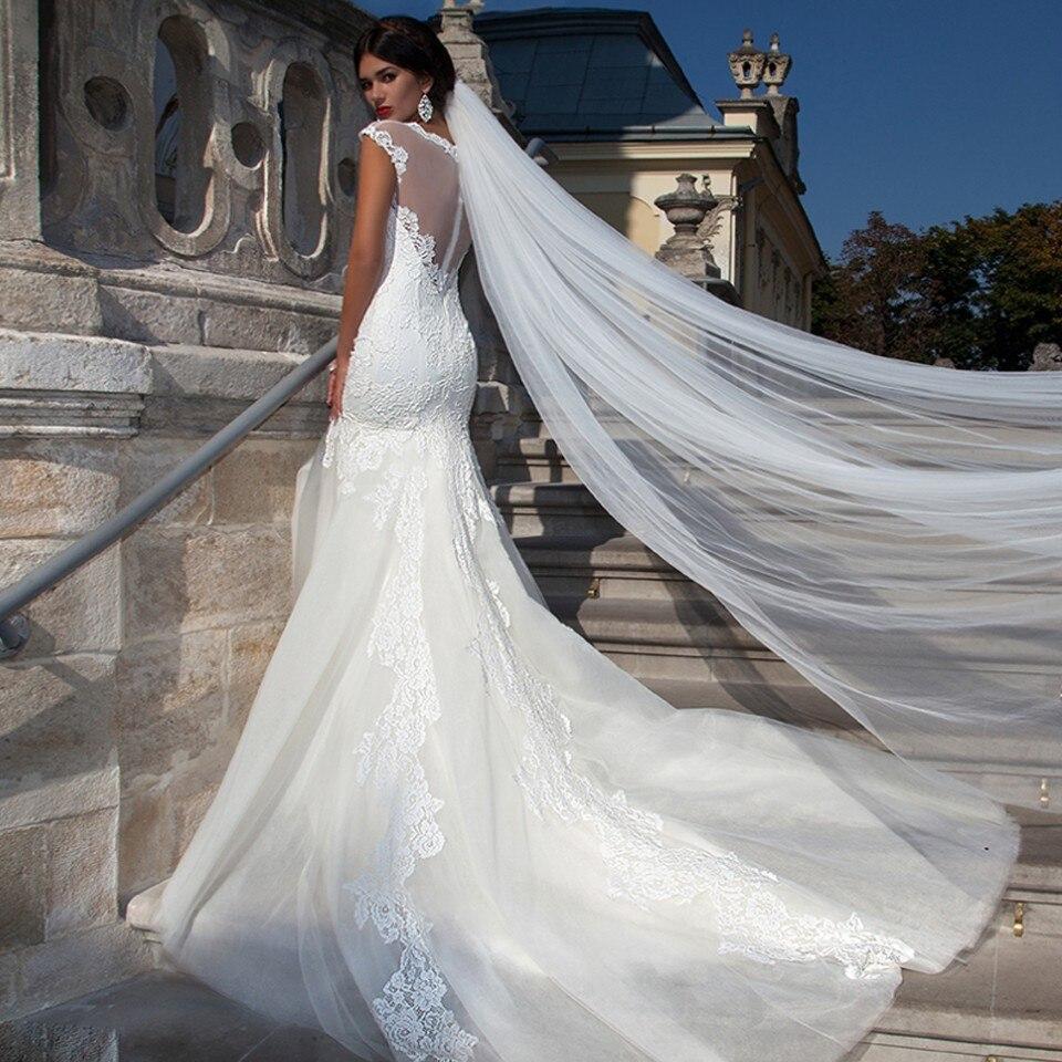 Vestidos de novia con velo largo