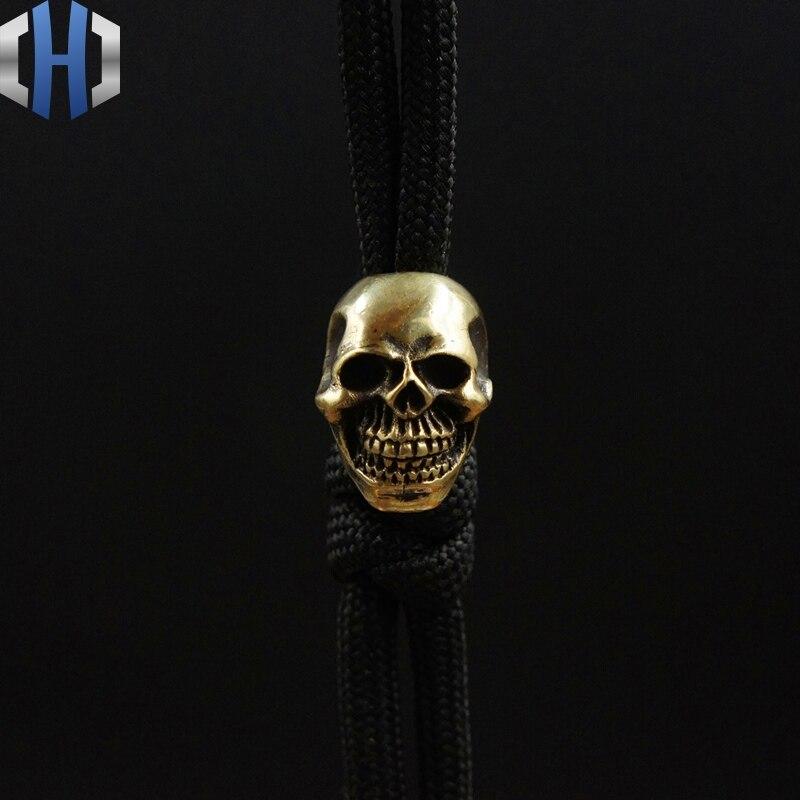 EDC colgante Paracord latón sonrisa cuchillo cráneo cuentas cobre puro linterna DIY cae cuerda colgante llavero colgante