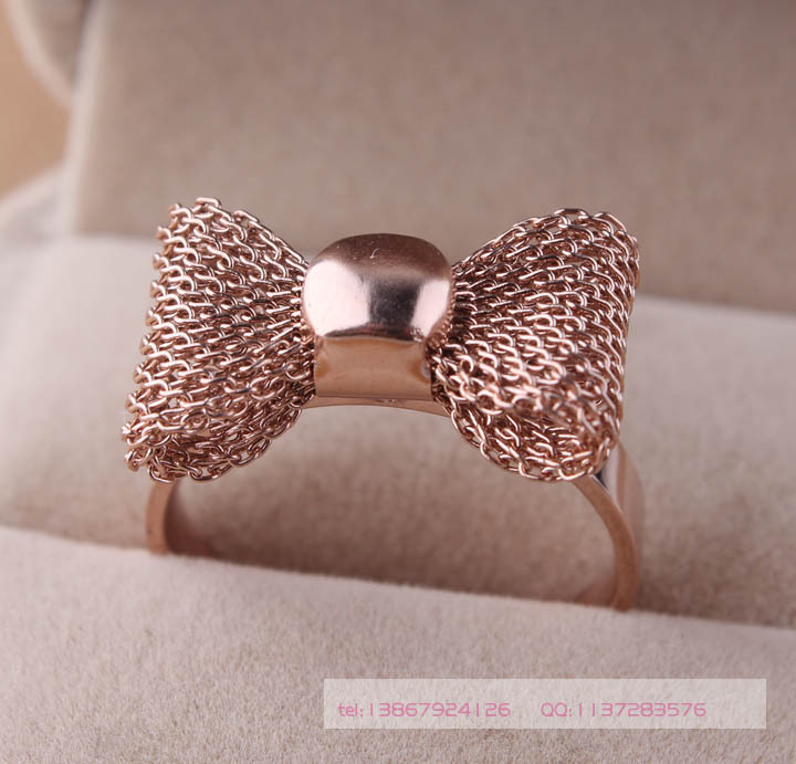 free shipping Wholesale New 2014 Fashion Jewelry 316l Stainless Steel Rose Gold color Reticular Bowknot Wedding Rings For Women