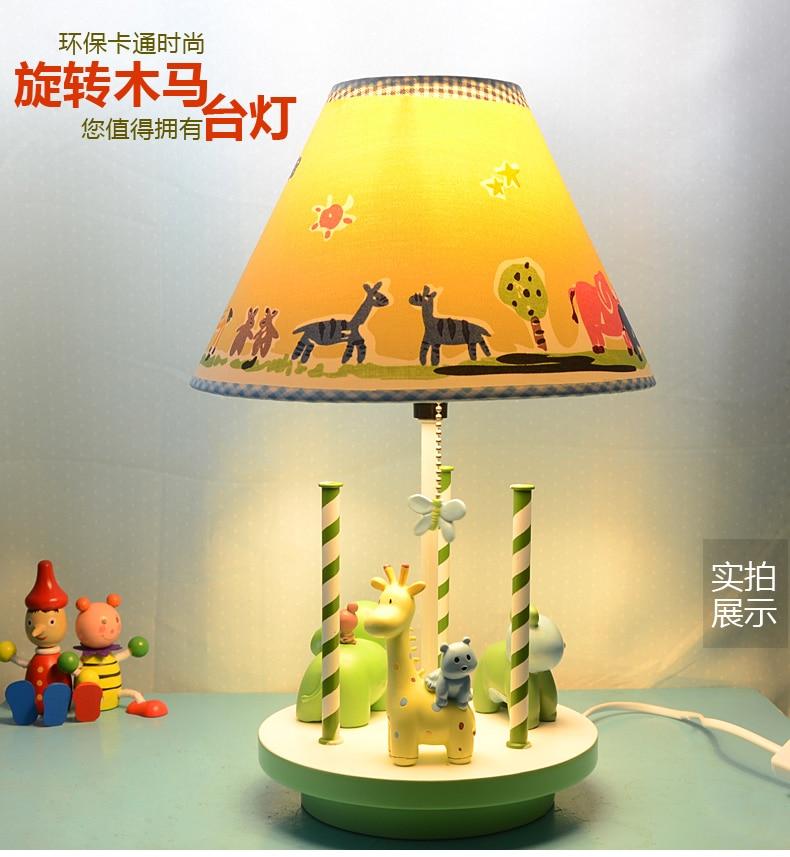 цена Rotating Trojan children's room table lamp cartoon animal LED cute creative bedroom lamp онлайн в 2017 году