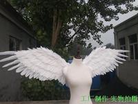 Beautiful birthday gifts nice white angel feather wings wedding home decoration supply Magazine shooting props
