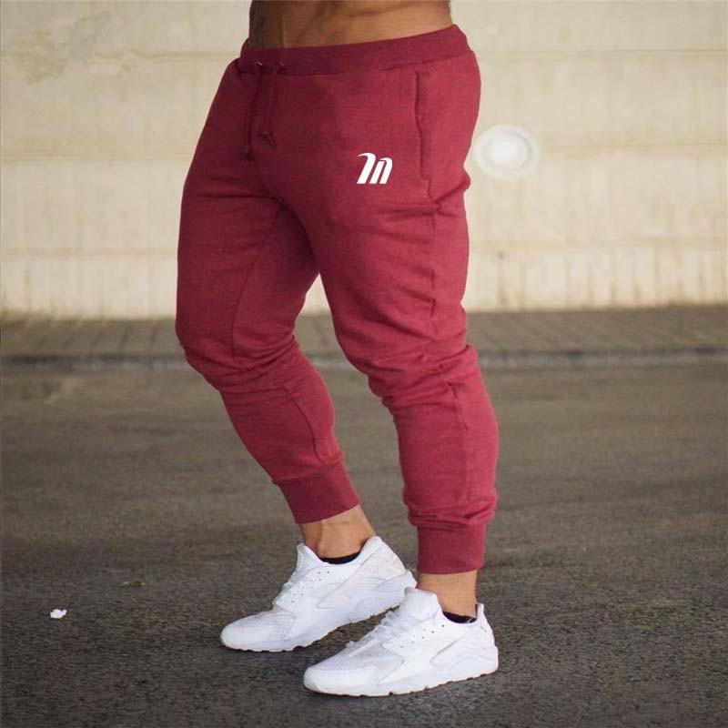 2018 Men Gyms Long pants Mid Cotton Men's Fashion Sporting workout fitness Pants casual sweatpants jogger pant skinny trousers