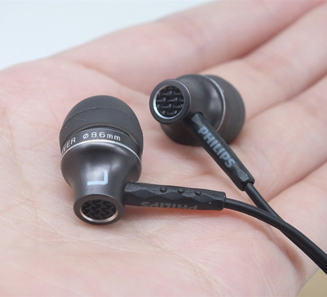 Original SHE9100 estéreo de metal Moda Deportes ejecutan auriculares In-Ear Auriculares con cable universal de doble auricular