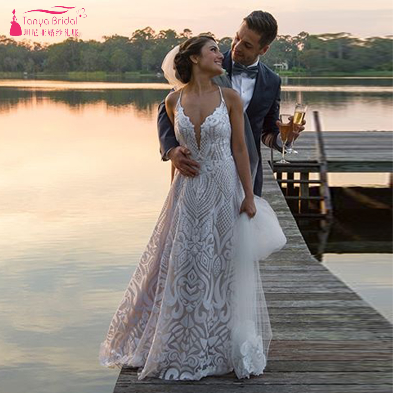 Sparkly Embroidery Wedding Dresses Nude Lining Deep V-Neck Luxury Bridal  Gowns Fashion Backless Vestido 2294ad5a2233