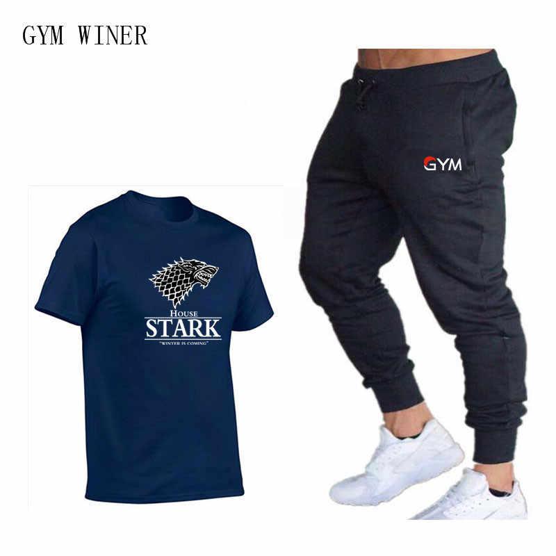 男性トラックスーツカジュアルパンツ + Tシャツセット 2 ピースフィットネス男性スポーツトラックスーツスキニースウェットパンツズボンジムトラックパンツ