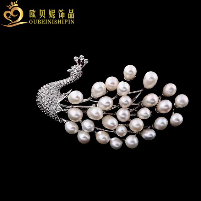 Obn hot moda jóias micro pave cz requintado grande pérola natural pavão broches emblemas pin pássaro presente para as mulheres
