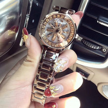2018 luxe merkhorloge dameshorloges van roestvrij staal diamant dameshorloge rotatie strass paars horloge klok