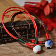 2 PCS Lucky Red Rope Bracelets Ceramic Beads Chain Cuff Bangles Statement Charm Wristbands Women Men Ethnic Jewelry Accessories(China)