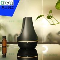 Unique Music 100ml Aroma Essential Oil Diffuser Ultrasonic Air Humidifier With 4 Timer Settings LED Color
