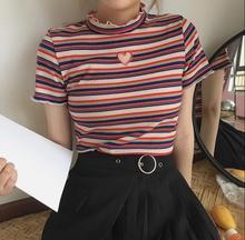 Pruhované tričko s krátkým rukávem a vyšším límcem