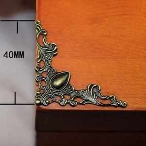 Image 1 - برونز تخريمي مثلث زهرة يلتف كابوشون ركن القلب القديم ديكورات معدنية مسطحة القصاصات 40 مللي متر 100 قطعة