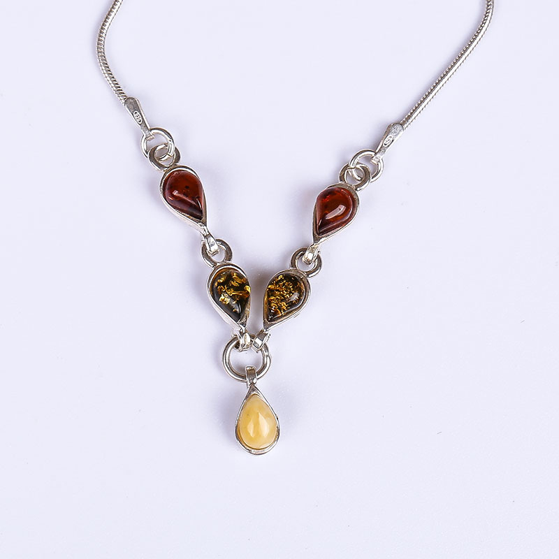 Europe and the United States simple drop-shaped 925 sterling silver inlaid 100% natural amber beeswax necklace female modelsEurope and the United States simple drop-shaped 925 sterling silver inlaid 100% natural amber beeswax necklace female models