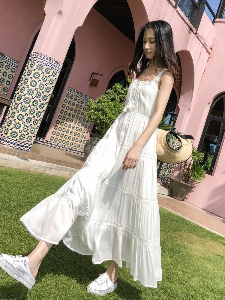 Haute qualité couleur unie nouvelles femmes vêtements plage robe femmes robes doux Style mince blanc robe bohème longues robes