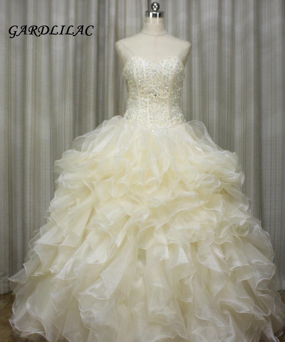 2017 Champgne robe de bal Quinceanera robes perles de cristal Organza volants longue robe de bal Vestidos de 15 Anos