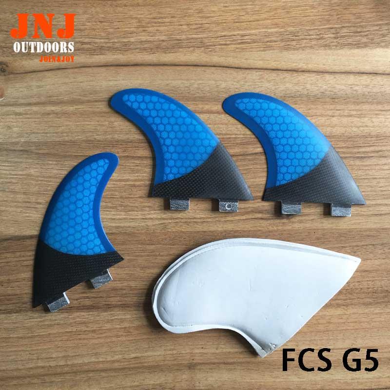 Pinne da surf a mezza costa in fibra di carbonio colore blu FCS G5 M con alette a nido d'ape