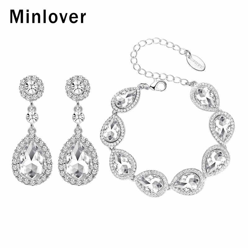 Minlover فضي اللون الدمعة كريستال العرسان سوار أقراط مجموعات للنساء مجوهرات الزفاف مجموعات قطرة الماء هدية EH070 + SL051